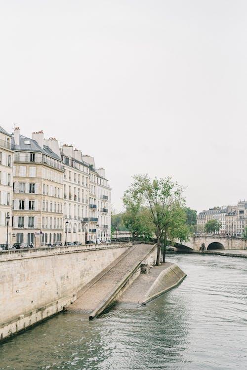 White Concrete Building Near River