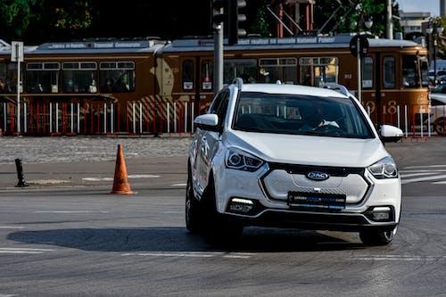 Hatchback white car driving on asphalt road