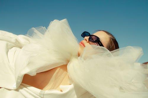 Stylish woman in trendy dress under sunlight