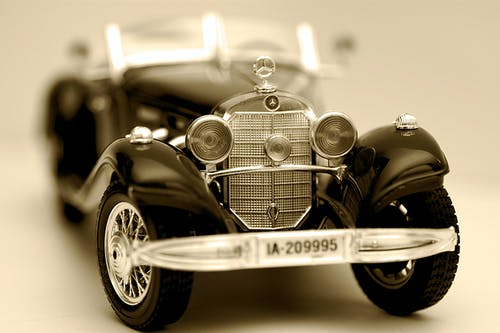 Selective Focus Photography of Vintage Black Car Scale Model
