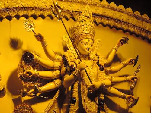 Gold Hindu Deity Figurine on Gold Frame