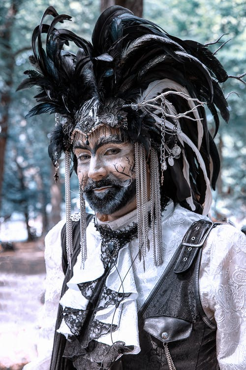 Man in Black and White Feather Headdress