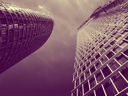 Low Angle and Sepia Toned Photography of Two High Rise Buildings