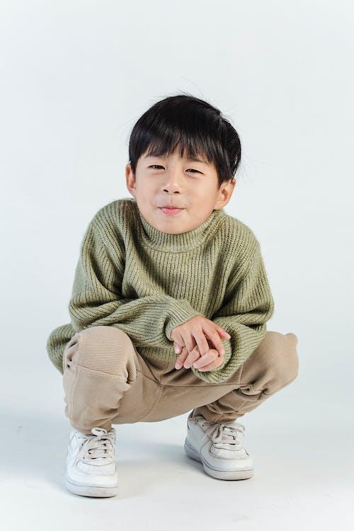 Cute little ethnic boy in stylish clothes