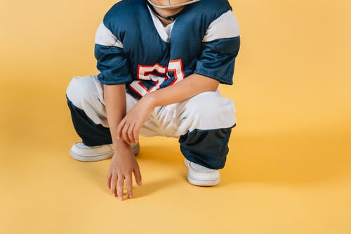 Small boy in uniform of sports player