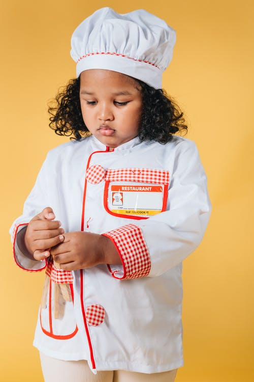 Little black girl in chef jacket