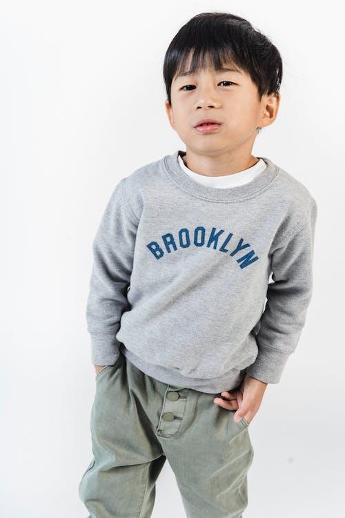 Little ethnic boy standing in studio