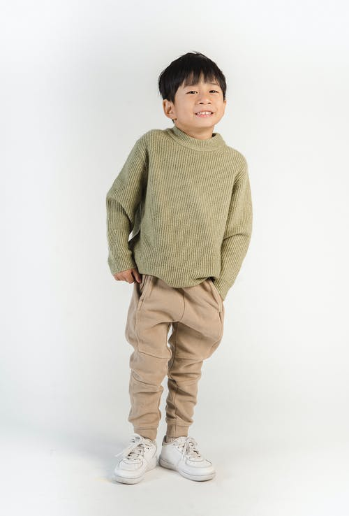 Stylish little cute Asian cheerful boy in trendy casual outfit