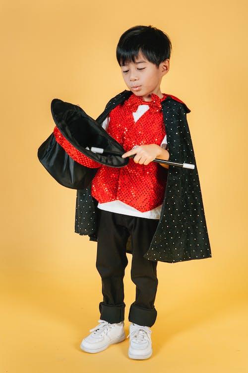 Little Boy in Magician Costume