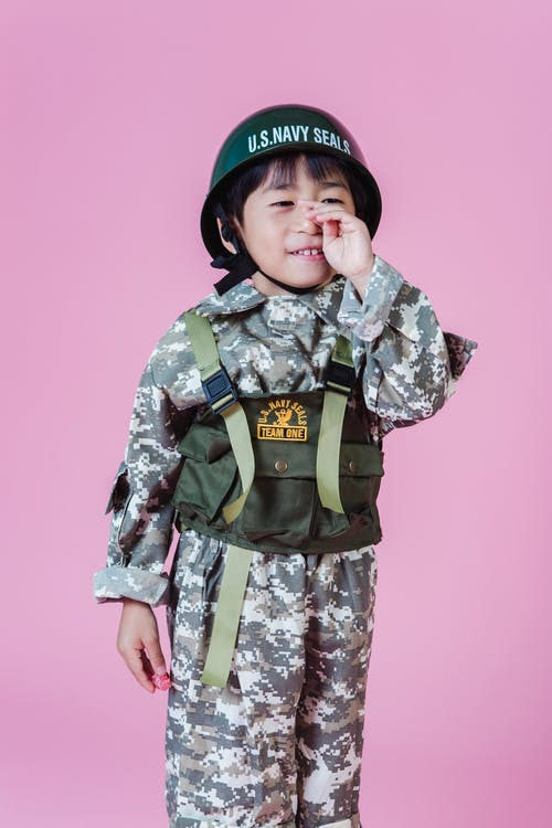 Ethnic child in military uniform in studio