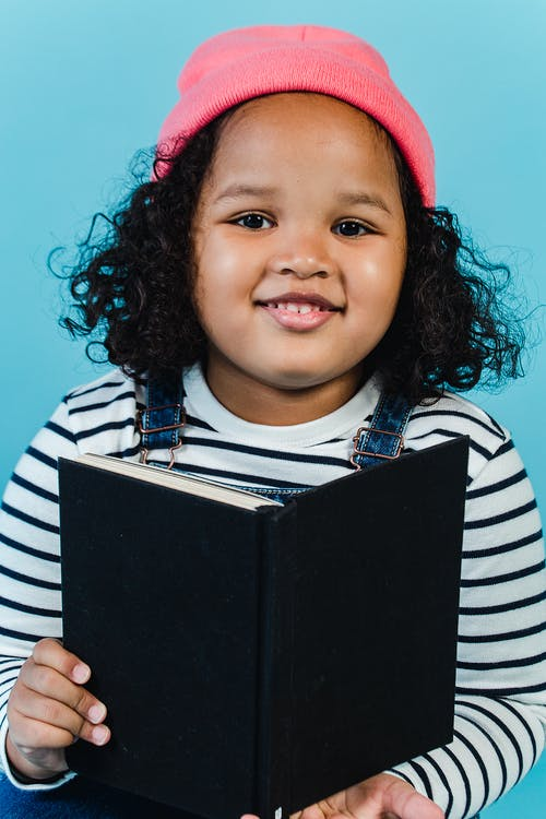 Positive black girl with book