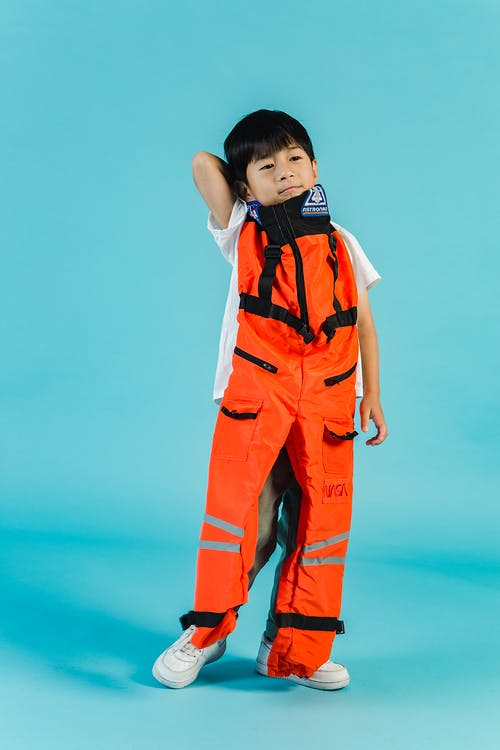 Content Asian boy with spacesuit