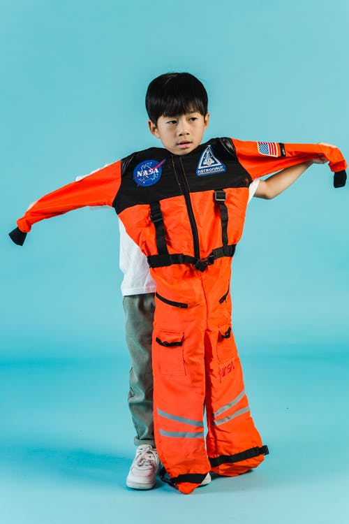 Asian boy with cosmonaut suit