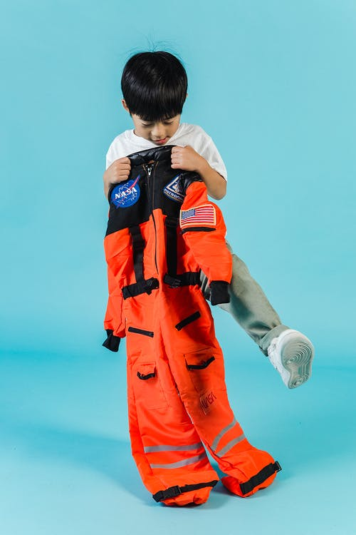 Cute Asian boy with cosmonaut suit