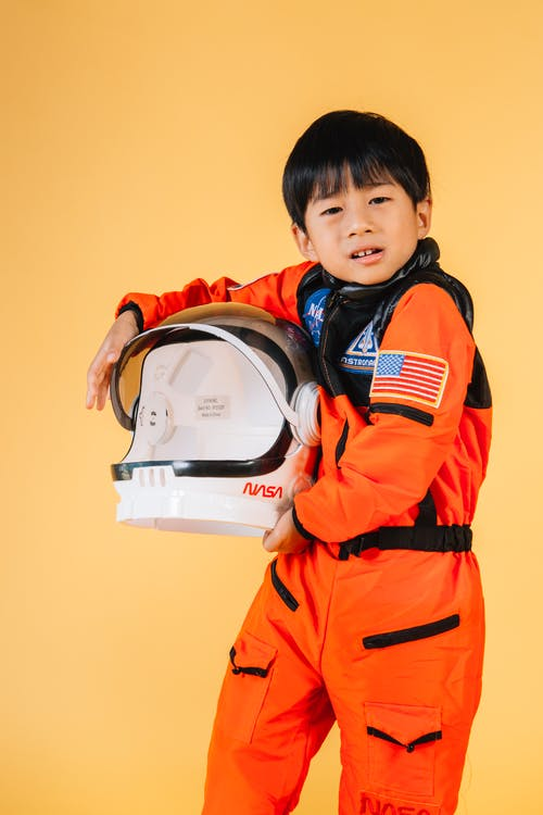 Cute Asian boy with astronaut helmet