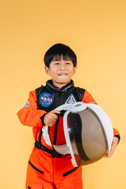 Cheerful Asian boy with astronaut helmet
