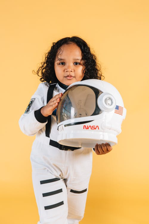 Calm ethnic girl with space helmet