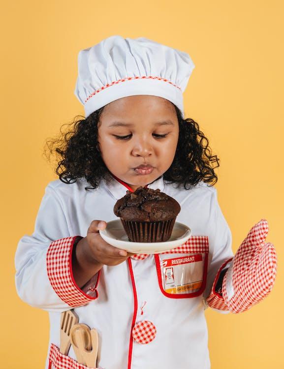 Little Kid Wearing Baker Costume
