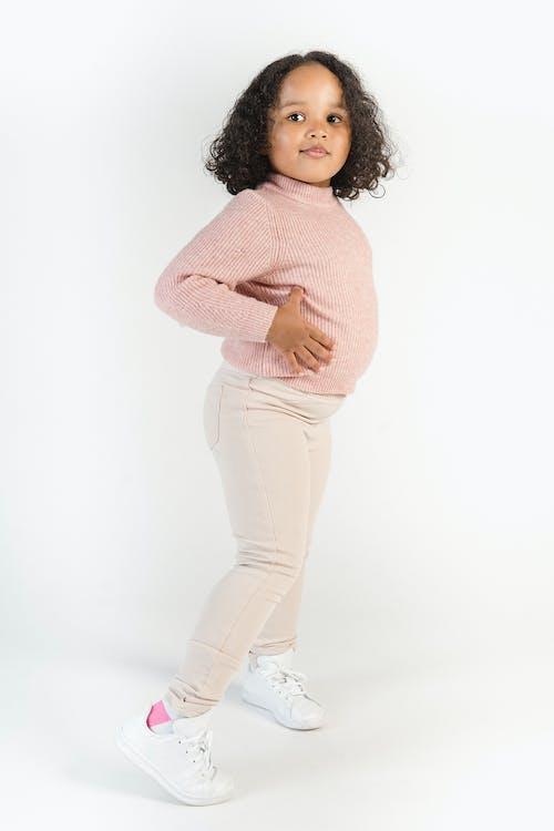 Cute stylish black girl with hands on waist