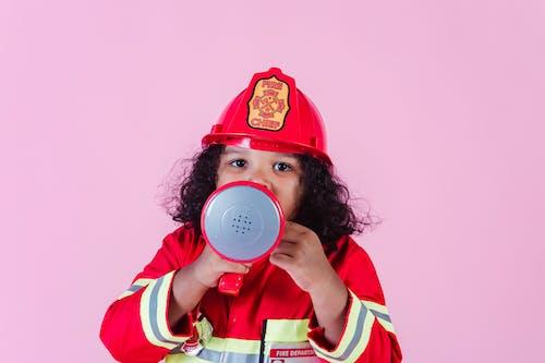 Cute black girl in firefighter uniform