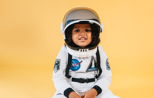 Little Kid Wearing Astronaut Costume