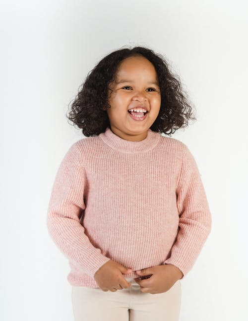 Girl in Pink Sweater Smiling