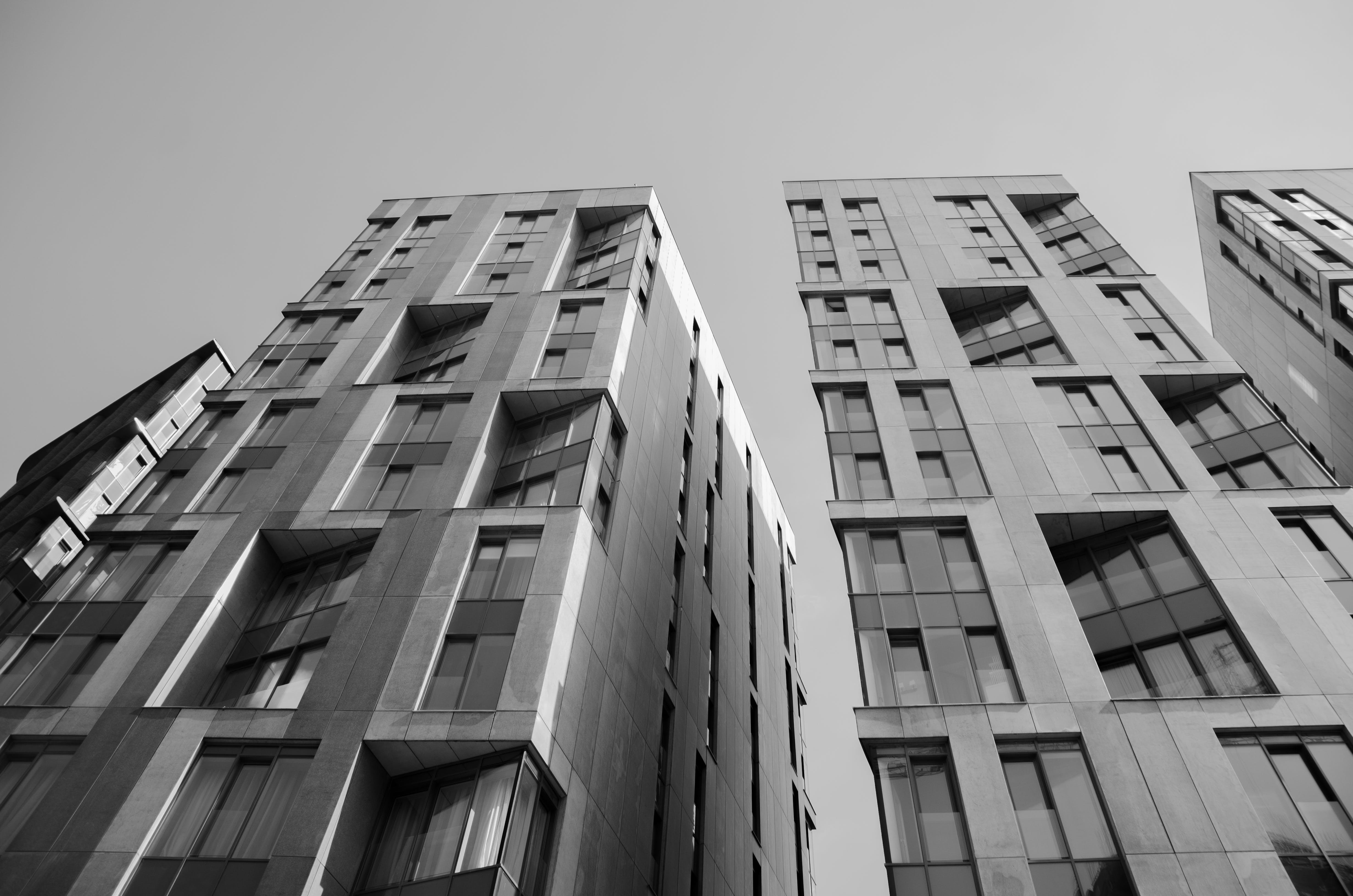 Worm's Eye View of Buildings in Grayscale Photography