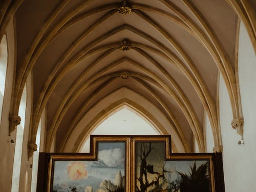Interior of cathedral aisle with painting