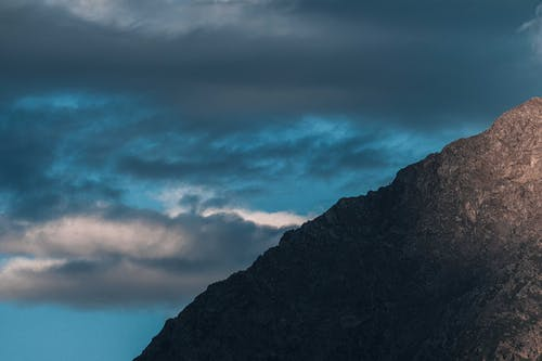 Mountain ridge in dark overcast weather