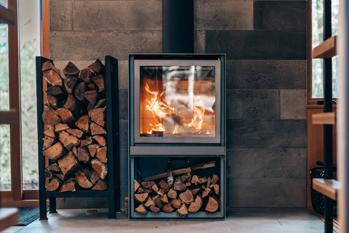 Creative fireplace with fuel woods in modern house