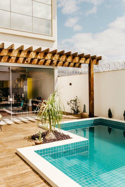 Pool placed on terrace near house