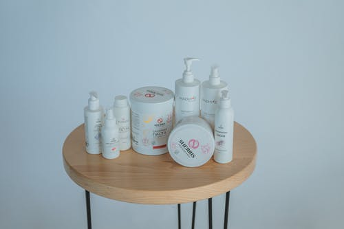 Cosmetic products on wooden table