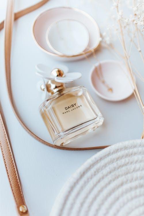 White Glass Perfume Bottle on White Table