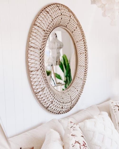 Creative oval shaped mirror on wall in living room
