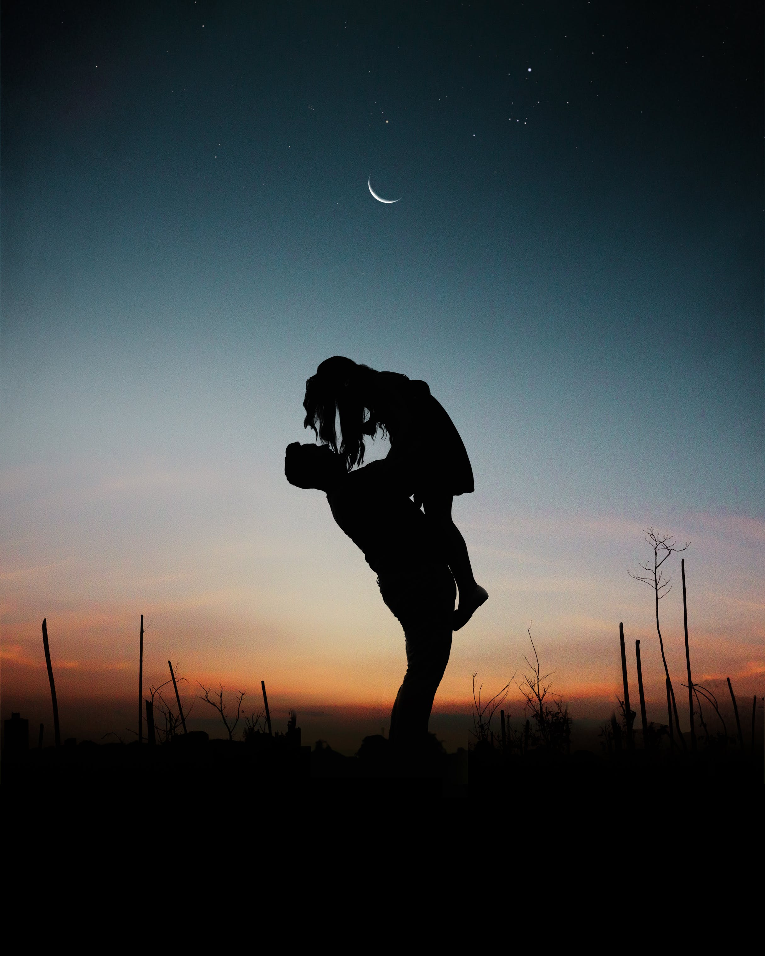 Silhouette of Man Lifting Woman