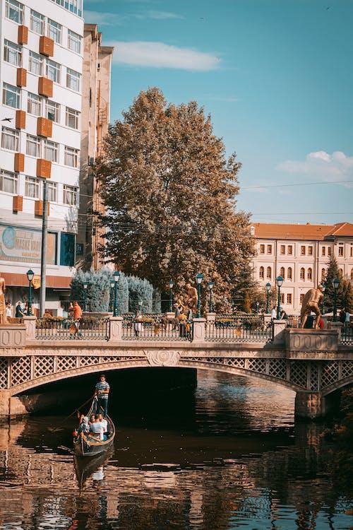 People Walking on Bridge over River