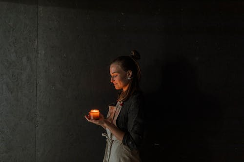 Woman in Black Jacket Holding Red Apple Fruit