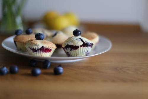 Selective-focus Photography of Cupcakes With Berries on Top