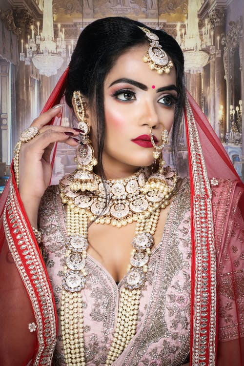 Woman in Gold and Silver Sari