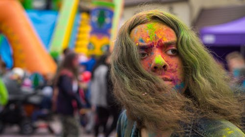 Woman With Green and Red Face Paint