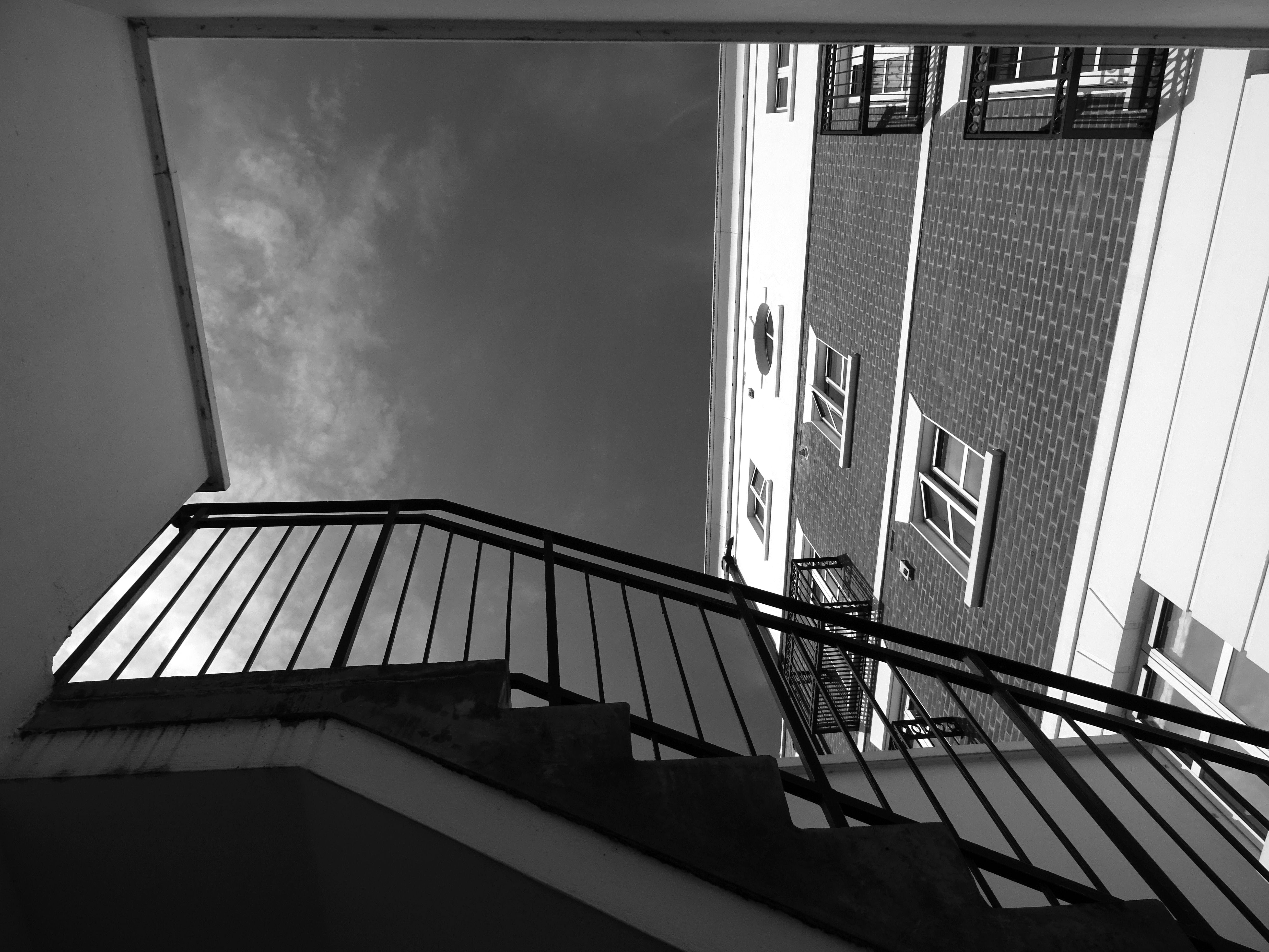 Free stock photo of stairs, black-and-white, sky, building