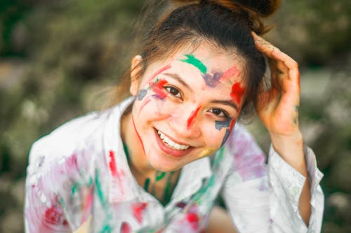 Charming woman with paint on face