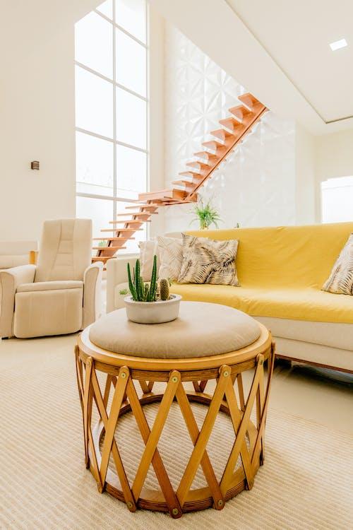 Minimalistic design in spacious living room in modern apartment