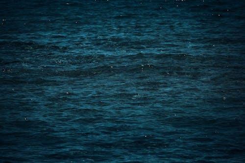Blue waving ocean water at daylight