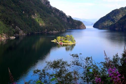 Yellow Kayak on Lake Near Green Mountains