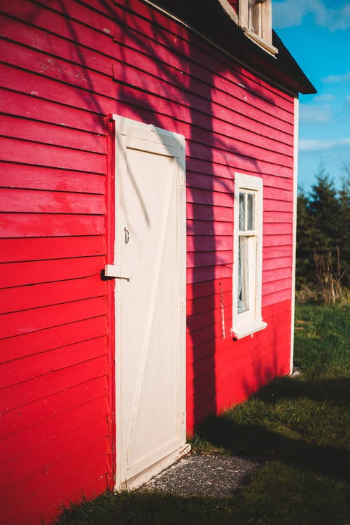 Old house with red walls in suburb