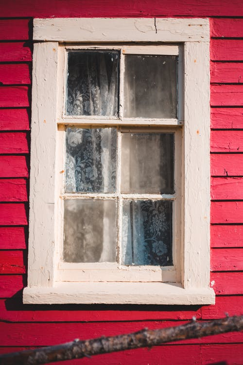 Aged window of bright residential rural house