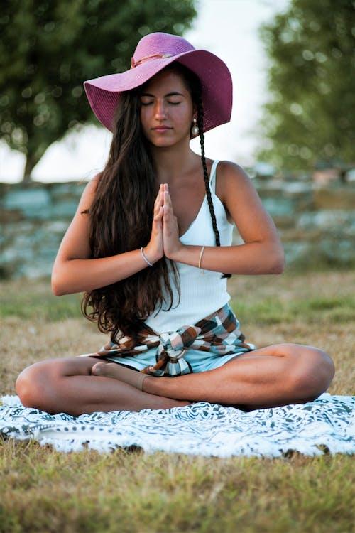 Woman Wearing a Pink Hat Meditating