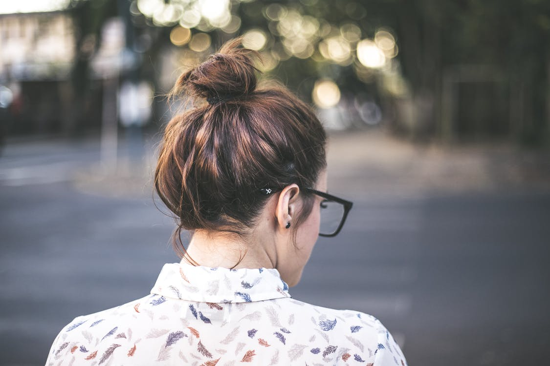 Woman Facing Backward in Selective Focus Photography