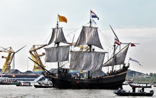 Brown and Black Sail Ship on Sea